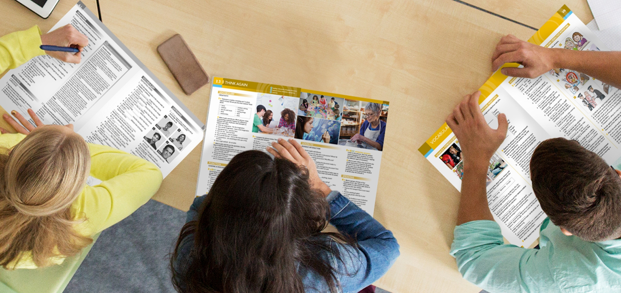Blooberry Design – Pearson – students looking at books – Publishing design